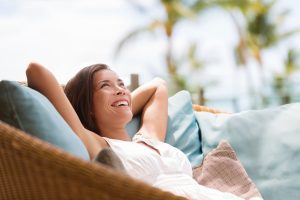Woman enjoying the shade under a solar pergola