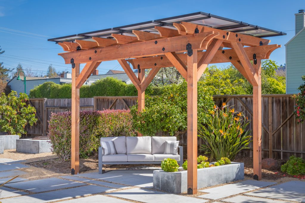 Shade Power solar pergola on a sunny day with seating in the shade