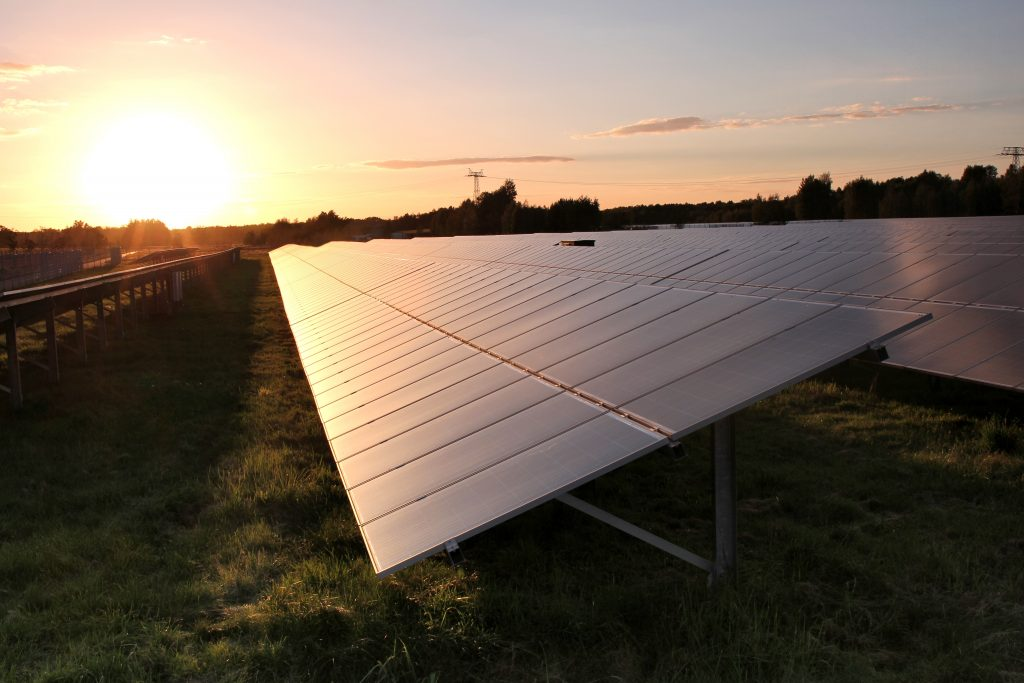 A ground mounted solar energy system installation in the early evening light.