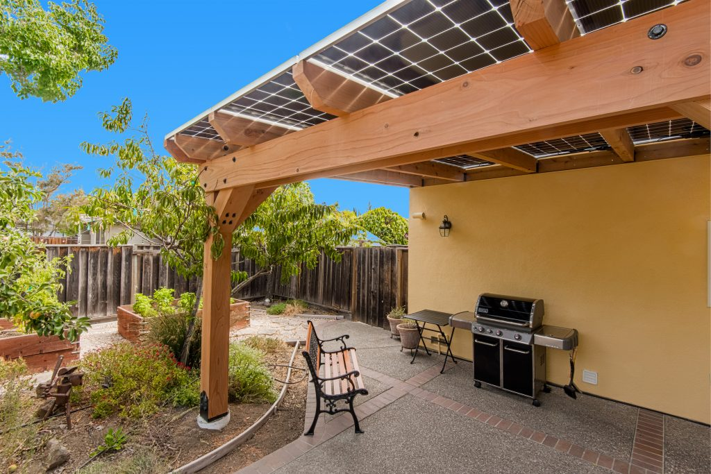 An angled view of a solar pergola with bifacial solar panels