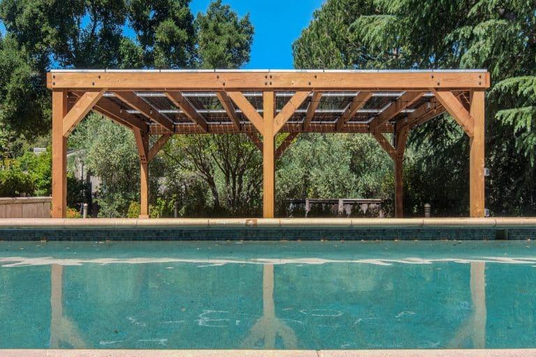 9.7 kW solar pergola showcasing contemporary design located next to a pool