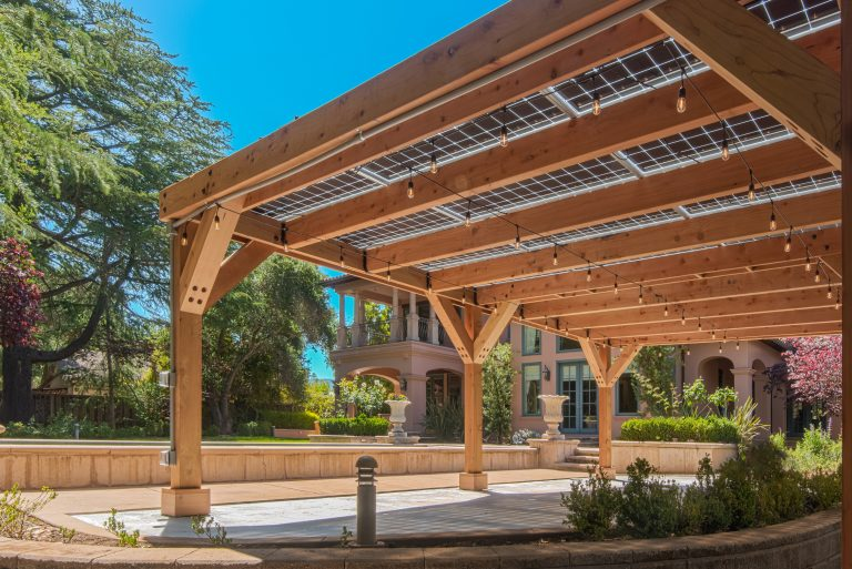 9.7 kW solar pergola showing the underside of the structure including market lights and bifacial solar panel design