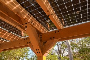 Showing the bottom of a solar carport made with redwood